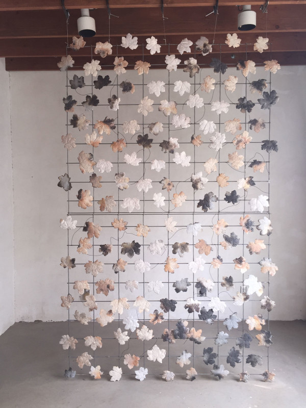 "Up is East, porcelain, steel, magnets, 9' 5'7"" x 2"", 2015"
