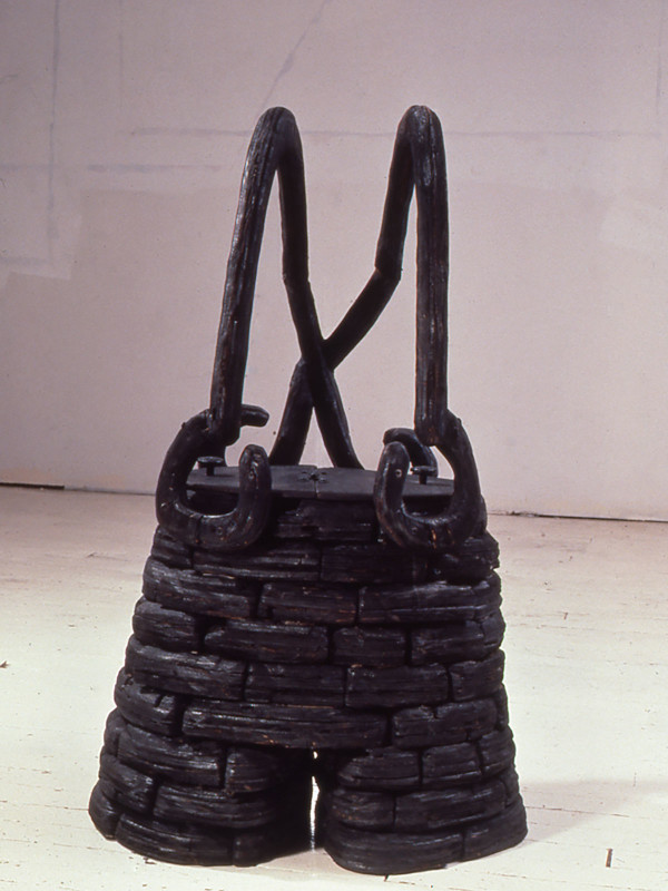 """Fortified Shorts, charred plywood, steel, 2'10"""" x 1'5"""" x 1'7"""", 1990"""