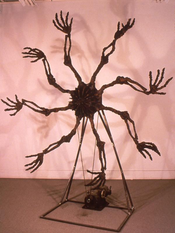 """Self Portrait as an Exhaust Fan, charred plywood, steel, motor, rope, 9'3"""" x 8' x 4', 1991"""