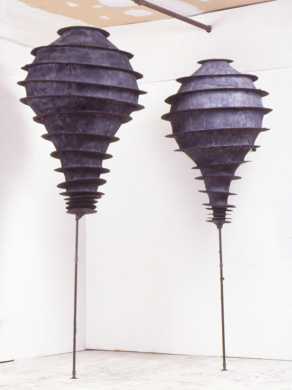 "Carbon Lightbulbs, graphic soaked felt, charred plywood, steel, 9'6"" x 3'6"", 1989"