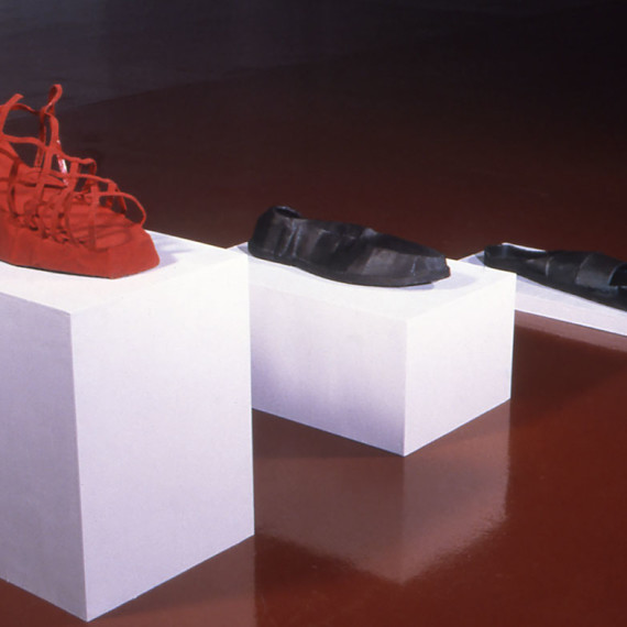 """A History of the World Through Shoes, steel, flocking, wood, 3' x 8'3"""" x 3'5"""", 2001"""
